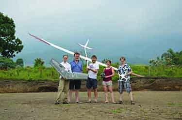 Photograph showing Matthew Watson from the University of Bristol and colleagues are with a DJI Phantom 3 Pro quadcopter, a Ritewing Zephyr 2 delta-wing aircraft and a small Thermik XXXL glider, which they used to map and monitor the Volcán de Fuego in Guatemala
