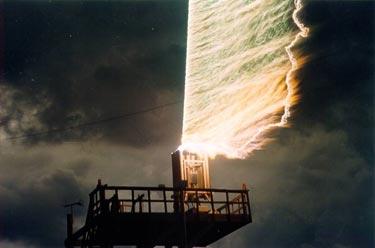 Rocket-triggered lightning strikes a control tower