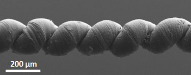 Wax-filled nanotube yarn