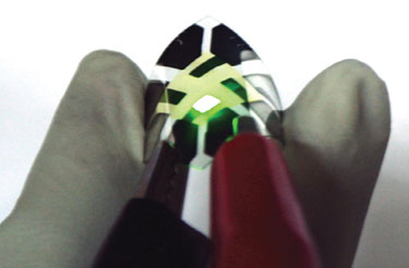 A fluorescent green graphene-anode OLED