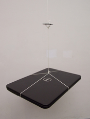 Image of a heavy laptop suspended from the supercapacitor