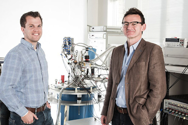 Menno Veldhorst (left) and Andrew Dzurak with the equipment use to cool and monitor their CNOT gate