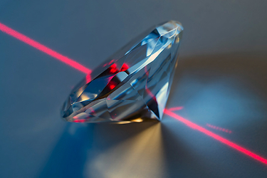 Photograph of a cut diamond and a laser beam