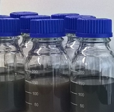 A photograph of bottled aqueous dispersions of nanopartiles.