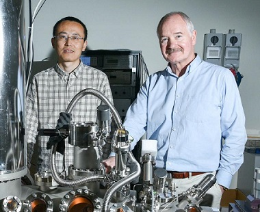 A photograph of Xiaopu Zhang and John Boland at the STM lab.