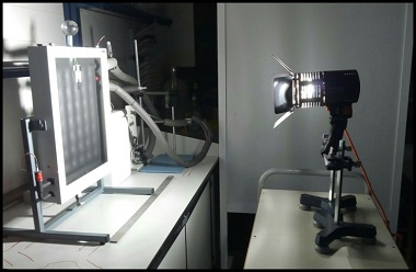A photograph of the solar collector experiment warmed by a halogen lamp. Adding graphene to the working fluid increased the temperature of the water bath and the outlet flow.