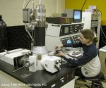 Alexandra Imre uses an electron-beam lithography system to pattern nanomagnet structures.