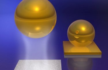 Casimir-Lifshitz force between a gold-coated ball and a silica plate in a fluid
