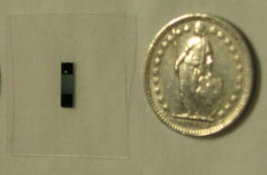The device as compared with a coin