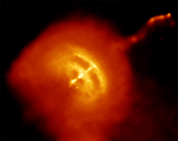 An image of the Vela pulsar (which lies at the heart of the Vela supernova remnant) in which glitching has been observed. The pulsar itself is the bright white spot at the centre of the hot gas, and a jet powered by its rotational pole is also observed in this Chandra X-ray Observatory image. (Courtesy: NASA/CXC/PSU/GPavlov <i>et al.</i>)