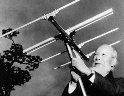 Hidetsugu Yagi holding his famous Yagi-Uda design of radio antenna