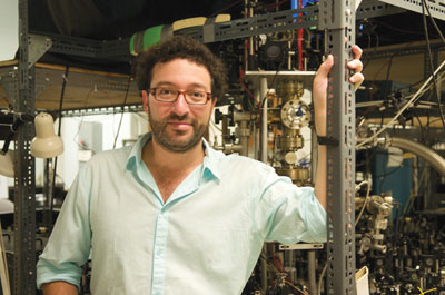 A photograph of Aephraim Steinberg in his lab at the University of Toronto