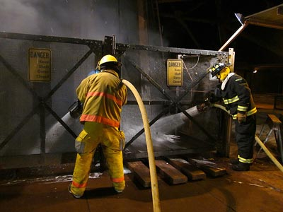 Photo of firefighters sending foam and water down the Soudan Mine access shaft