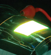 Photo of flexible display being patterned with LEDs