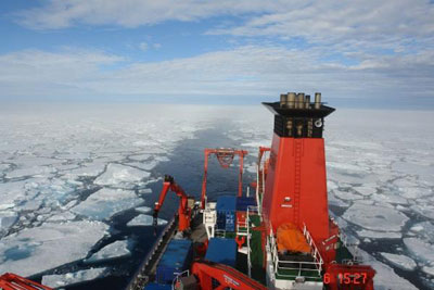 Photo of a German research vessel moving through sea ice in the Fram Strait