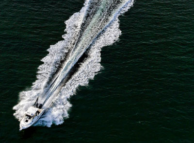 Photograph of a boat cutting a wake