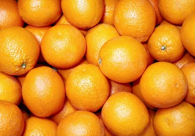 Photograph of stacked oranges