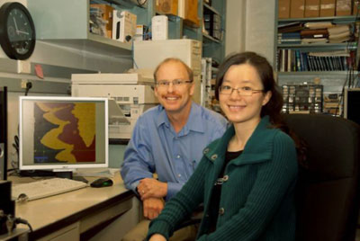 A photograph of Rodney Ruoff and Shanshan Chen in the lab where the thermal conduction studies were carried out
