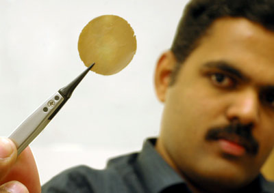 Photo of Manchester physicist Rahul Nair holding a graphene membrane