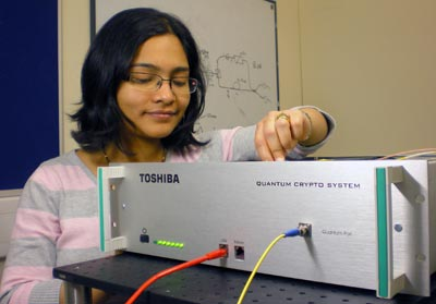 Photo of a Toshiba researcher with quantum-cryptography equipment