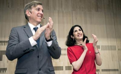Photo of Joseph Incandela (left) and Fabiola Gianotti