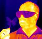 Infrared image of Radislav Potyrailo holding a butterfly