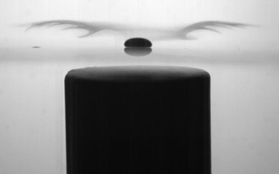 Image of a liquid-oxygen Leidenfrost drop, levitating over a glass plate, with a magnet underneath