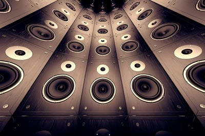 Illustration of a wall of speakers