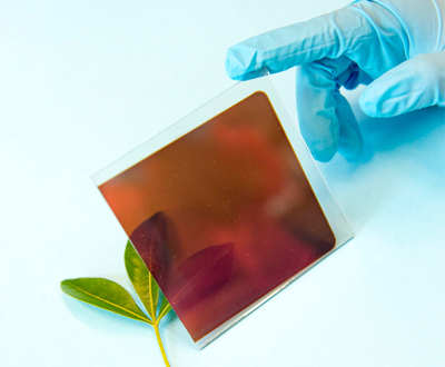 Photograph of an semi-transparent organometal halide perovskite fabricated on a glass sheet