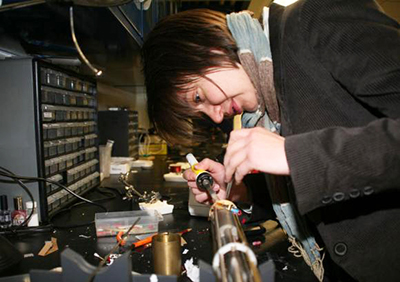 Photograph of physicist Vesna Mitrovic working on equipment in her lab at Brown University